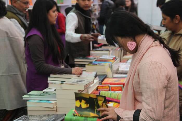 A literature enthusiast checks in at the bookstore at the 7th Jaipur Literary festival. According to the organizers, a record number of books were sold at the store.
