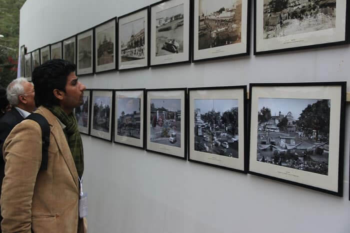 A visitor looks at the photo exhibition organized on the first day of the 7th Jaipur Literary festival.
