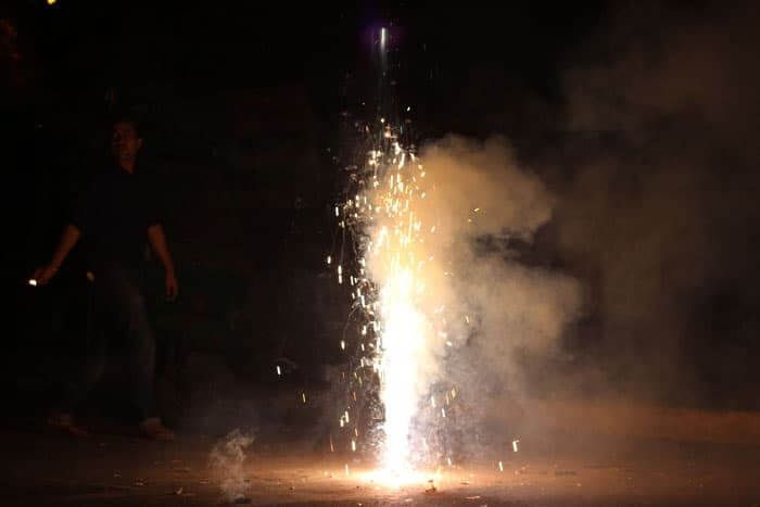 A large firework sprays up into the air at a Diwali festivalays.