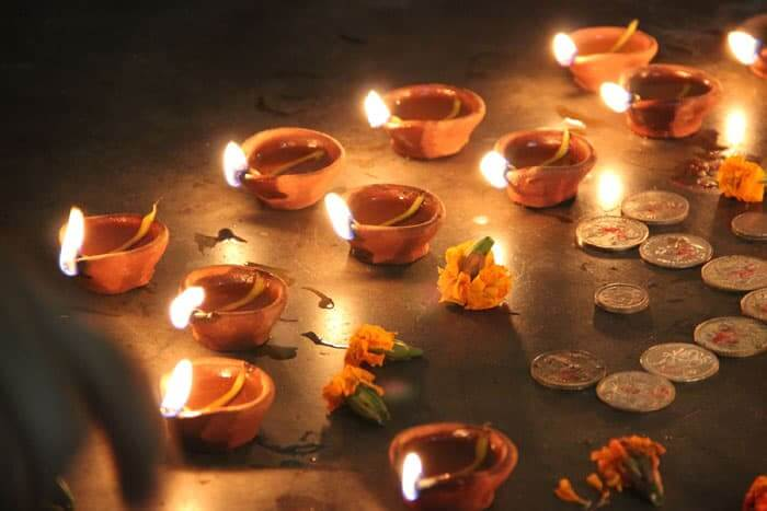 Light oil-filled lamps are used tp decorate the homes for Diwali