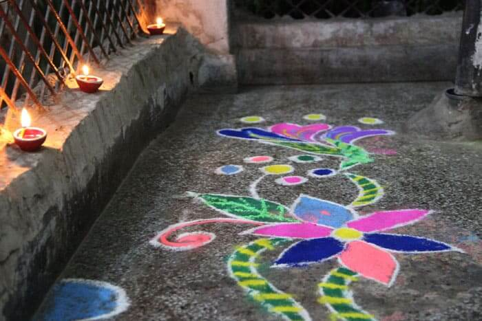 Rangoli is a colourful pattern made from dyed powders and flowers to welcome the goddess Lakshmi.
