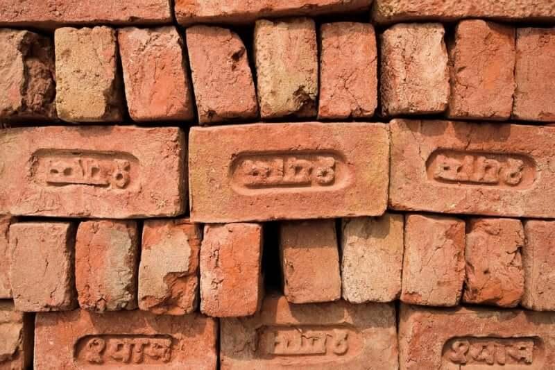 red sanskrit bricks.