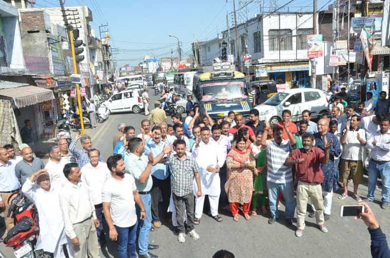 protestors hold up traffic at main chowk.