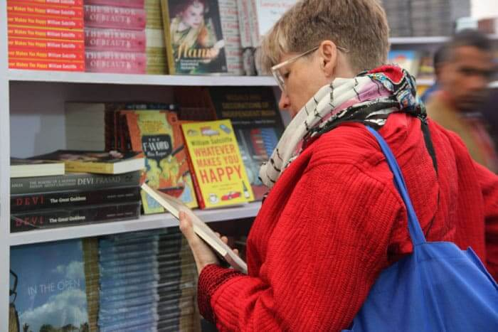 A foreign visitor looks at books in the bookstore at the 7th Jaipur Literary festival.
