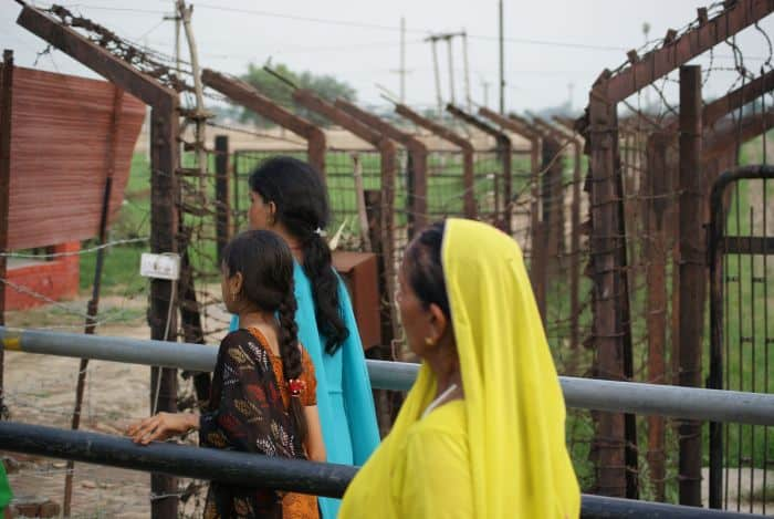 Women wait at an India-Pakistan border crossing