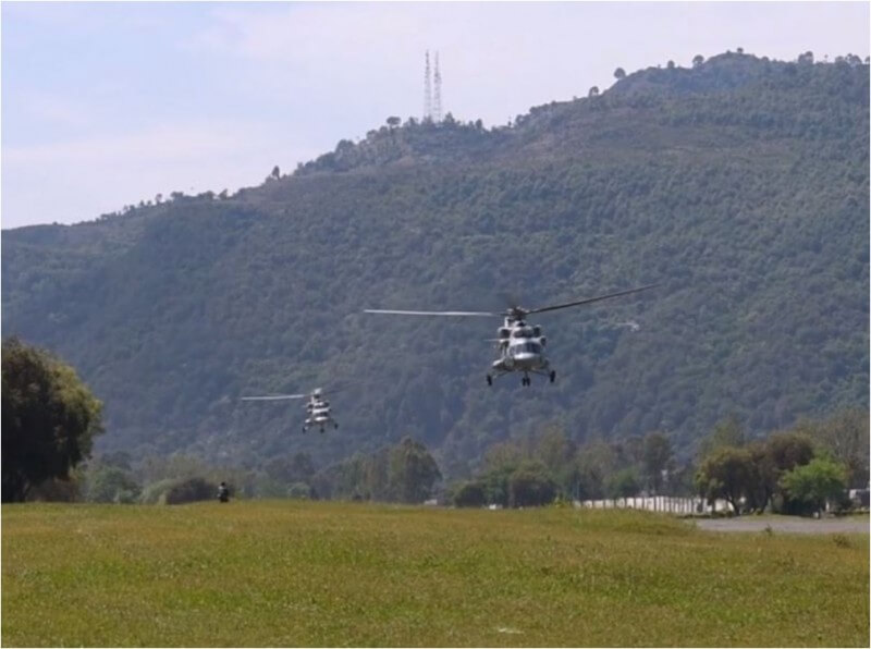 IAF military helicopters taking off.