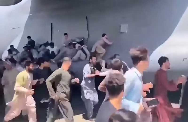 Afghan residents try to flee from afghanistan airport chaos. youtube screenshot.