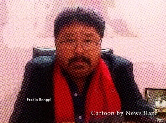 Pradip Rongpi in his office. Cartoon by NewsBlaze.